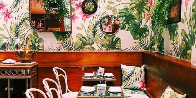 Instagram worthy restaurant with plant wallpaper