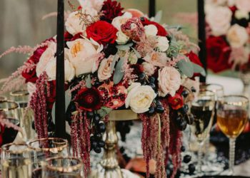 black candles with beautiful flower arrangement
